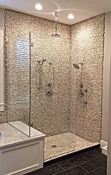 """The Riverstone - an amazing frameless shower. The 3/8""""ShowerGuard® Glass is almost unnoticeable. The two glass panels are attached using Satin Chrome finished hardware. This shower has no door, allowing for ease of access."""