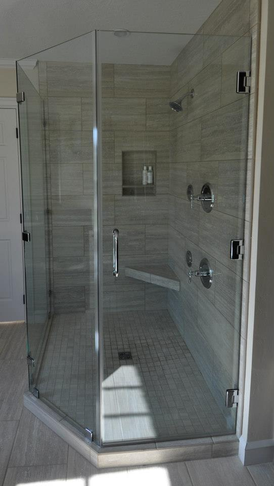 """The Suffolk - an historic, remodeled home has a new frameless shower using 3/8"""" ShowerGuard® Tempered Safety Glass set at a neo angle with Chrome finished hardware. This is a beautiful master bath."""